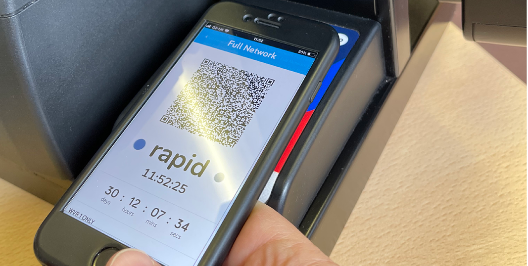 Image of a hand using a touch and go mobile app ticket